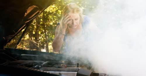Car Emergency Kit Smoke From Woman's Car Engine