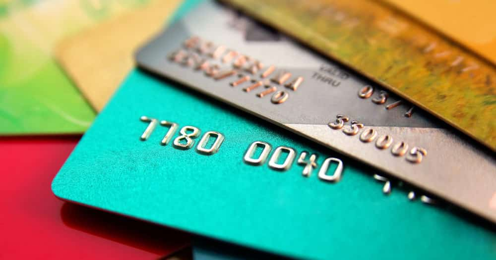 Stack Of Multicolored Credit Cards Representing Reducing Expenses And Debt
