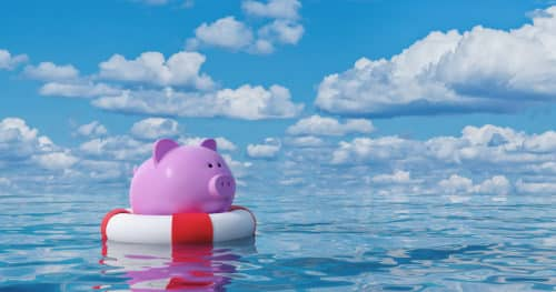Emergency Fund Piggy Bank Floating On Life Raft