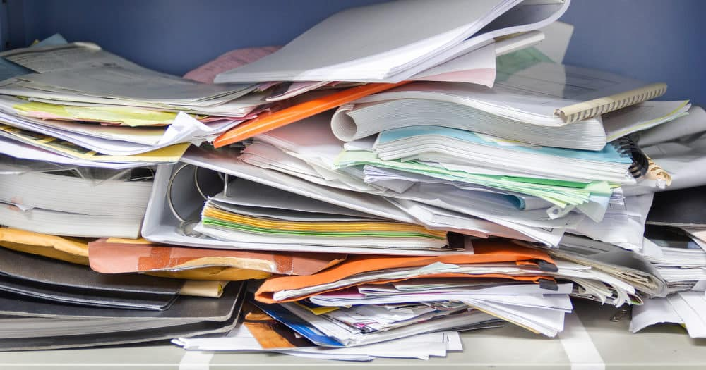 Messy Files And Documents Representing Need To Organize Finances