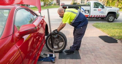 Roadside Service AAA Changing A Flat Tire