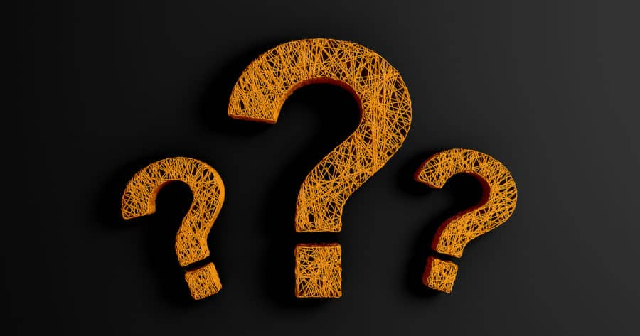 Three Question Marks On Black Background