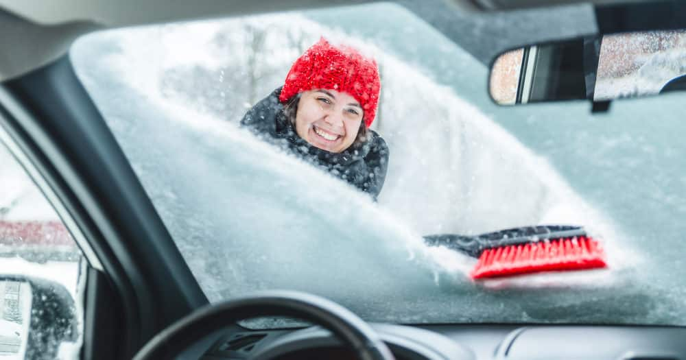 Weather Conditions Cleaning Car After Snow Storm