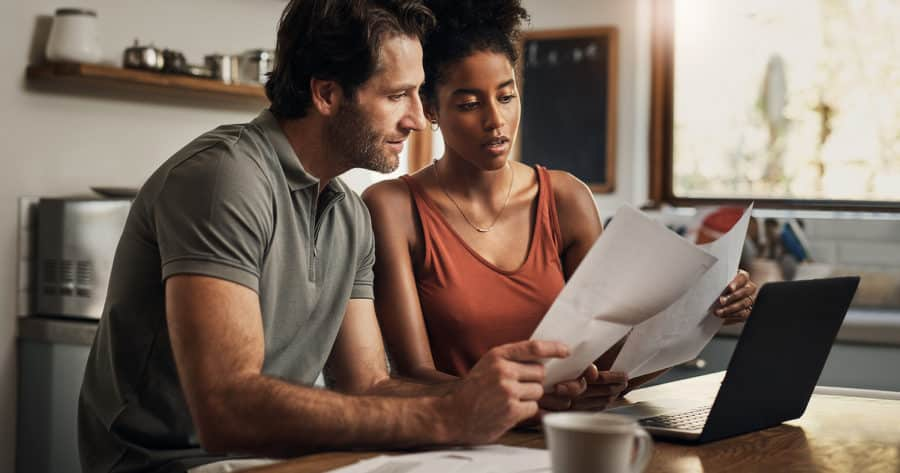 Young Couple Estate Planning And Writing A Will For Financial Preparedness